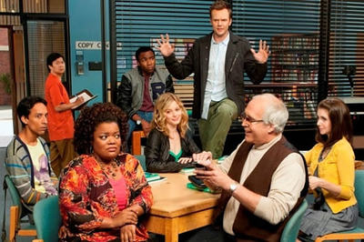 The cast of Community in their study room