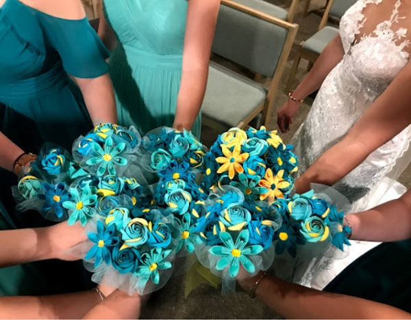 Bouquets of teal and yellow paper flowers