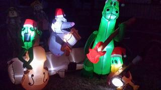Inflatable animals holding instruments